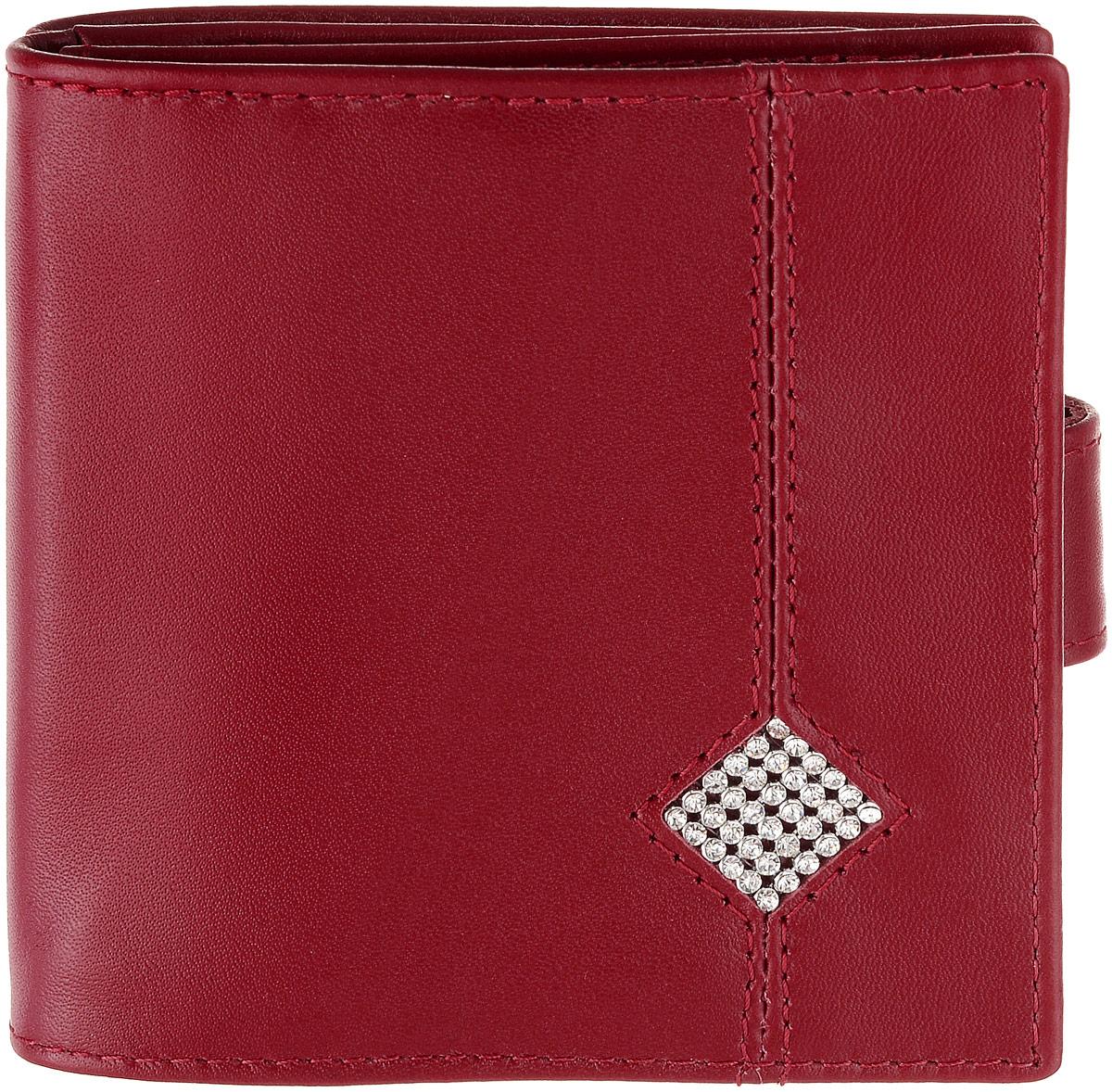 Кошелек женский Dimanche Рубин, цвет: красный. 019019Стильный женский кошелек Dimanche Рубин выполнен из натуральной кожи и оформлен стразами. Изделие имеет два отделения, одно из которых закрывается на кнопку, второе - на хлястик с магнитной кнопкой. Внутри одного из отделений находится четыре кармашка для визиток и пластиковых карт и карман для мелочи, закрывающийся на клапан с кнопкой. Внутри второго отделения располагаются два отделения для купюр. Снаружи, между отделениями располагается карман для бумаг. Изделие упаковано в фирменную коробку. Стильный кошелек Dimanche Рубин станет отличным подарком для человека, ценящего качественные и практичные вещи.