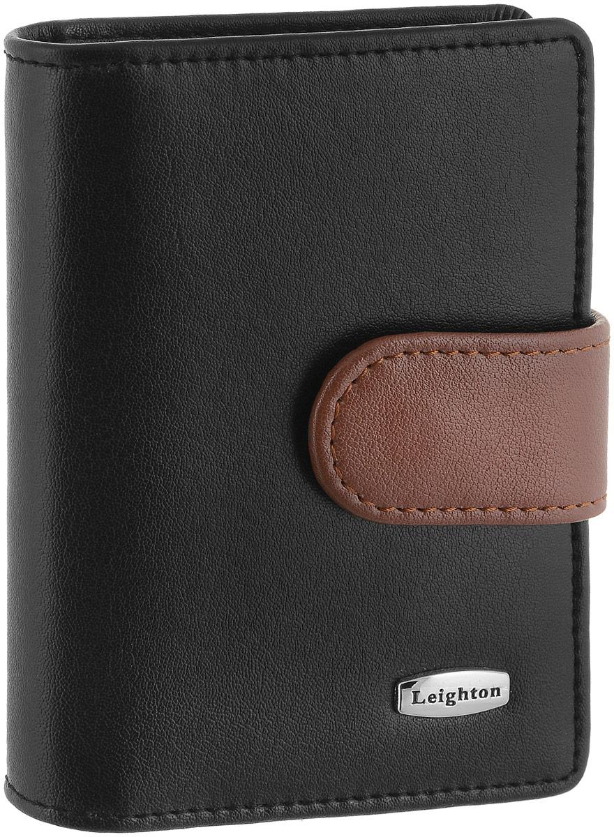 Визитница женская Leighton, цвет: черный, коричневый. 22108-1/1022108-1/10 черн/корВизитница Leighton выполнена из натуральной кожи и оформлена металлической пластинкой с названием бренда. Изделие закрывается хлястиком на кнопки. Внутри расположены два боковых открытых кармана для пластиковых карт, один из которых с пластиковым окошком. Также внутри находится блок с 20 файлами для карт. Изделие упаковано в фирменную коробку.