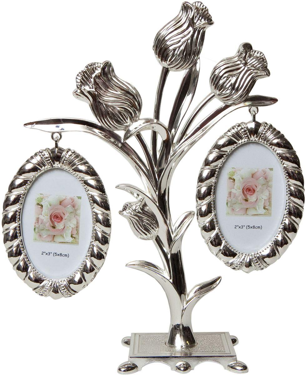 Фоторамка Platinum Дерево. Цветы, цвет: светло-серый, на 2 фото, 5 x 8 см. PF96762 фоторамки на дереве PF9676Декоративная фоторамка Platinum Дерево. Цветы выполнена из металла. На подставке в виде цветов подвешиваются две овальные рамочки. Изысканная и эффектная, эта потрясающая рамочка покорит своей красотой и изумительным качеством исполнения. Фоторамка Platinum Дерево. Цветы не только украсит интерьер помещения, но и поможет разместить фото всей вашей семьи. Высота фоторамки: 20 см. Фоторамка подходит для фотографий 5 x 8 см. Общий размер фоторамки: 18 х 4 х 20 см.