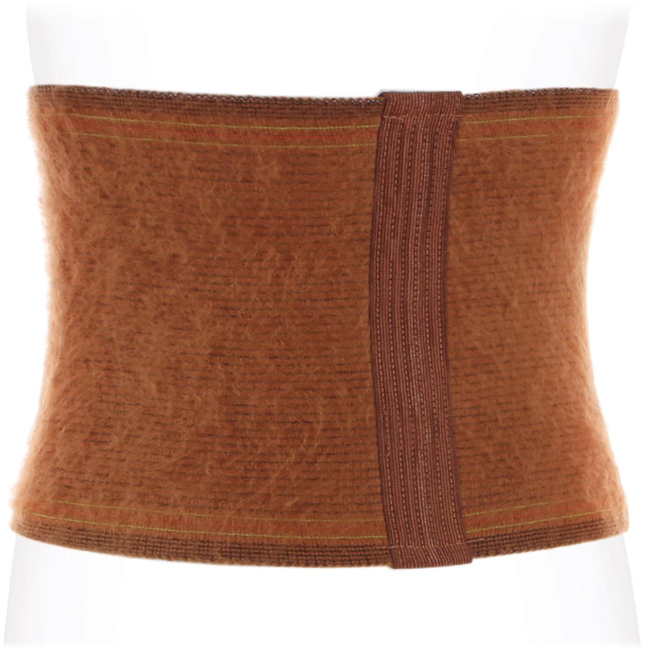 Ecoten Бандаж противорадикулитный согревающий. Верблюжья шерсть ПРР-03. Размер 3/XLПРР-03 XLОсобенности: активно нейтрализует токсины, вырабатываемые организмом и оказывает косметологическое воздействие на кожу, омолаживая и делая ее более упругой и эластичной защищает от замерзания в холод и от перегрева в жару в несколько раз прочнее других видов шерсти обладает высокими антистатическими свойствами практична в носке, устойчива к загрязнению и способна самоочищаться цвет: коричневый Показания к применению: радикулит, миозит ревматизм, остеохондроз поясничного отдела позвоночника неврит, невралгия, подагра профилактика заболеваний поясничного отдела позвоночника при физических нагрузках и переохлаждении 42(S)65-85 44(M)83-100 46(L)98-115 48(XL)113-130 состав:верблюжья шерсть