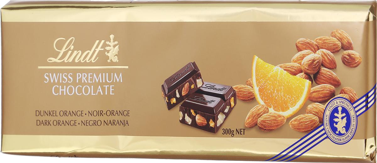Lindt темный шоколад с апельсином и миндалем, 300 г7610400069267Лакомство, в котором прекрасным образом сочетаются премиальный шоколад, сочный апельсин и цельный миндальный орех. Изготовленный по традиционному швейцарскому рецепту, шоколад обладает нежной бархатистой текстурой, которая интересно контрастирует с хрустящим миндалем, а апельсин придает лакомству особенные, приятно освежающие нотки. Чтобы почувствовать все богатство вкуса этого шоколада им нужно наслаждаться не спеша, уютно устроившись с чашечкой свежезаваренного чая или кофе. Уважаемые клиенты! Обращаем ваше внимание, что полный перечень состава продукта представлен на дополнительном изображении.