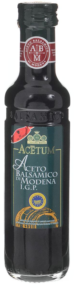 Acetum Бальзамический уксус из Модены, 250 мл830701Именно из итальянского города Модена, славящегося на весь мир производством лучшего бальзамического уксуса, происходит бальзамический уксус Acetum. Знак сертификации I.G.P. подтверждает, что каждая бутылка произведена только с использованием местного сырья в соответствии с установленным строгим регламентом. Бальзамический уксус Acetum обладает характерным темным цветом, утонченным кисло-сладким вкусом и пряным ароматом. Он идеален в качестве основы для различных маринадов, соусов и дрессингов, а также является изысканным завершением овощных, мясных и рыбных блюд. Уважаемые клиенты! Обращаем ваше внимание, что полный перечень состава продукта представлен на дополнительном изображении.
