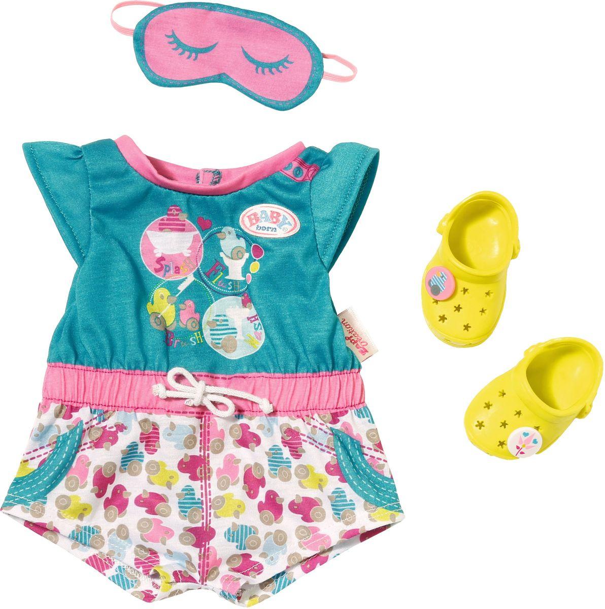Baby Born Пижамка с обувью для кукол822-470Комплект одежды для куклы Baby Born включает пижамку с веселыми принтами, ярко-желтые кроксы, чтобы не ходить босиком по холодному полу, и повязку на глаза для спокойного сна.