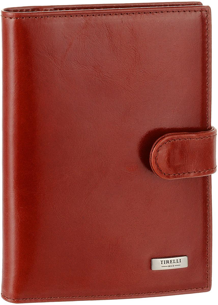 Обложка для автодокументов женская Tirelli, цвет: красно-оранжевый. 15-320-2515-320-25Женская обложка для автодокументов Tirelli выполнена из натуральной кожи. Изделие раскладывается пополам и закрывается на хлястик с кнопкой. Обложка содержит съемный блок из шести прозрачных файлов из мягкого пластика, три боковых кармана и четыре прорезных кармана для пластиковых карт. Изделие упаковано в фирменную коробку. Модная обложка для автодокументов поможет сохранить их внешний вид и защитить от повреждений.