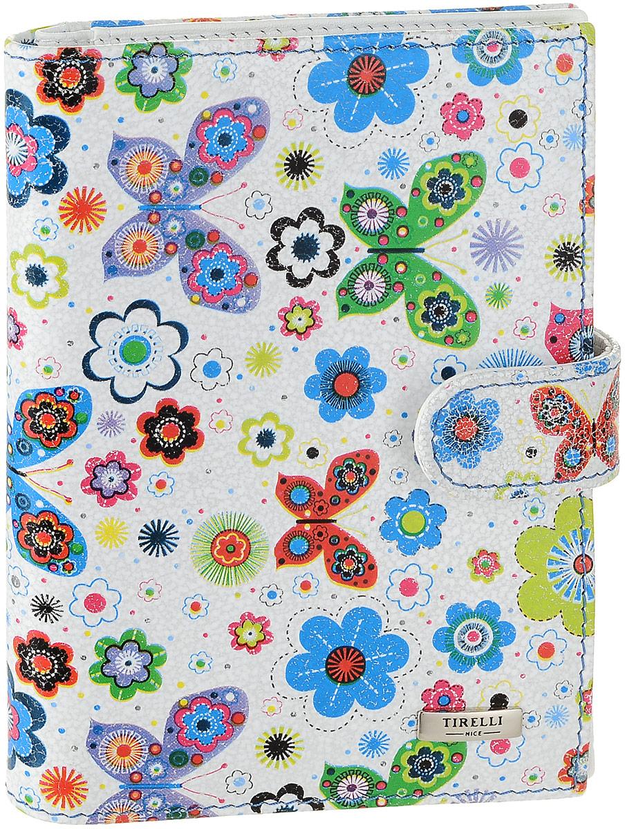 Обложка для автодокументов женская Tirelli Бабочка, цвет: светло-серый, мультиколор. 15-331-2615-331-26Женская обложка для автодокументов Tirelli Бабочка, выполненная из натуральной кожи, оформлена изображением цветов и бабочек. Изделие раскладывается пополам и закрывается на хлястик с кнопкой. Обложка содержит съемный блок из шести прозрачных файлов из мягкого пластика, один из которых формата А5, три боковых кармана, четыре прорезных кармана для пластиковых карт и отделение для паспорта с боковыми сетчатыми карманами для фиксации. Изделие упаковано в фирменную коробку. Модная обложка для автодокументов поможет сохранить их внешний вид и защитить от повреждений.