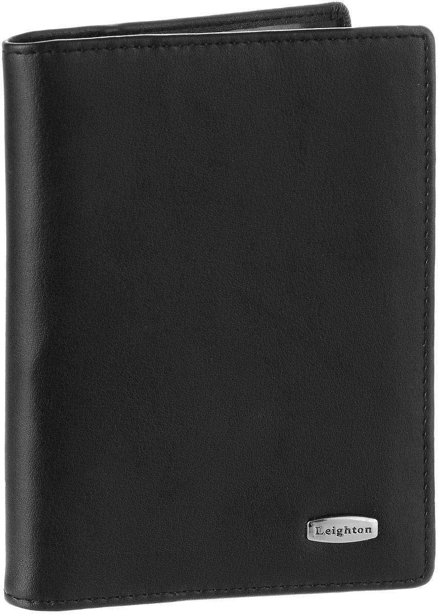Обложка для автодокументов женская Leighton, цвет: черный. 221322136 чернЖенская обложка для автодокументов Leighton выполнена из натуральной кожи. Изделие раскладывается пополам. Обложка содержит съемный блок из шести прозрачных файлов из мягкого пластика, один из которых формата А5 и два боковых прозрачных кармана. Изделие упаковано в фирменную коробку. Модная обложка для автодокументов поможет сохранить их внешний вид и защитить от повреждений.