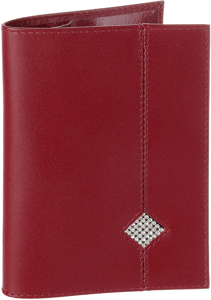 Обложка для паспорта Dimanche Рубин, цвет: красный. 010010Обложка для паспорта Dimanche Рубин выполнена из натуральной высококачественной кожи. На внутреннем развороте два кармана из прозрачного пластика. Снаружи обложка оформлена аппликацией из стразов в виде ромба. Упаковано изделие в фирменную картонную коробку. Такая обложка станет отличным подарком для человека, ценящего качественные и стильные вещи.