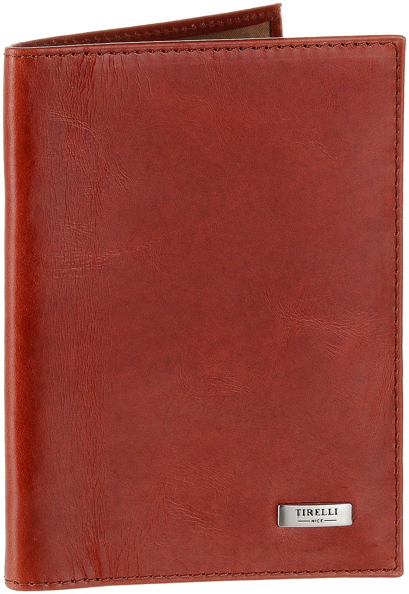 Обложка для паспорта женская Tirelli, цвет: красно-оранжевый. 15-333-2515-333-25Женская обложка для паспорта Tirelli выполнена из натуральной кожи. Внутри расположены боковые прозрачные карманы из пластика для фиксации паспорта. Изделие упаковано в фирменную коробку. Такая обложка не только поможет сохранить внешний вид ваших документов, но и станет стильным аксессуаром, идеально подходящим вашему образу.