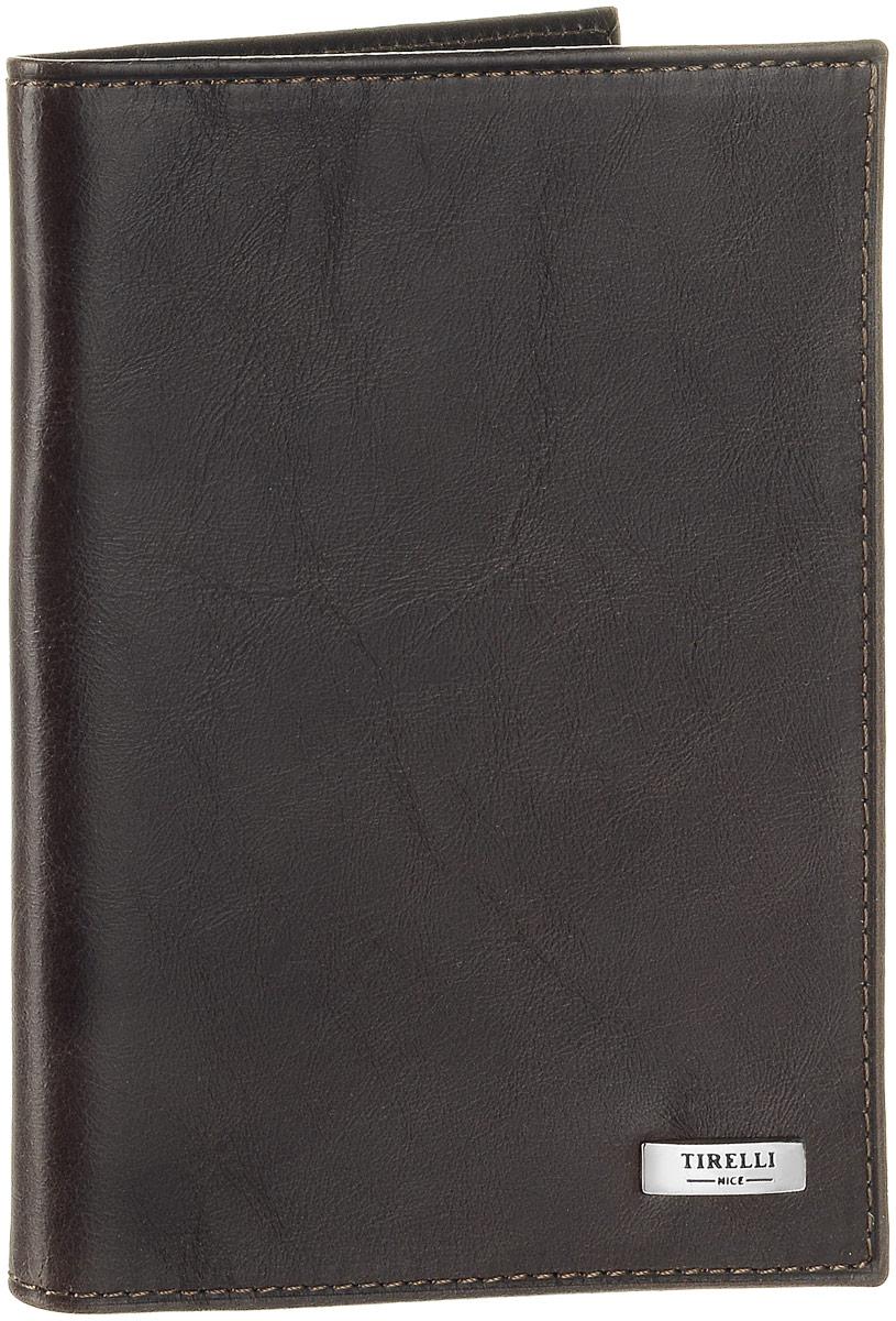Обложка для паспорта Tirelli Денвер, цвет: коричневый. 15-333-1215-333-12Обложка для паспорта Tirelli Денвер изготовлена из натуральной кожи коричневого цвета с матовой текстурой. Внутри два вертикальных кармана из прозрачного пластика. Такая обложка не только поможет сохранить внешний вид ваших документов и защитит их от повреждений, но и станет ярким аксессуаром, который подчеркнет ваш образ. Изделие упаковано в подарочную коробку синего цвета с логотипом фирмы Tirelli. Характеристики: Материал: натуральная кожа, текстиль, пластик. Цвет: коричневый. Размер обложки (в сложенном виде): 13,5 см х 9,5 см.