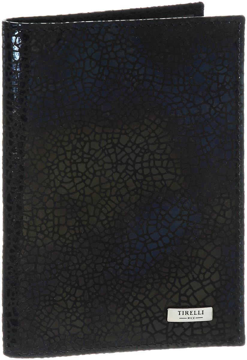 Обложка для паспорта женская Tirelli Ночное небо, цвет: черный. 15-333-3015-333-30Обложка для паспорта Tirelli Ночное небо выполнена из натуральной кожи с фактурной поверхностью. Внутри расположены боковые прозрачные карманы из пластика для фиксации паспорта. Изделие упаковано в фирменную коробку. Такая обложка не только поможет сохранить внешний вид ваших документов, но и станет стильным аксессуаром, идеально подходящим вашему образу.