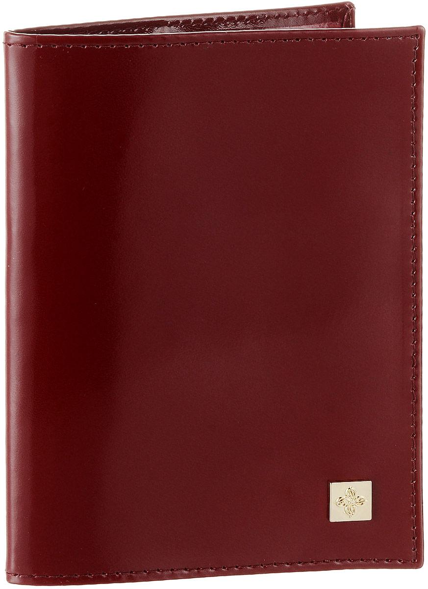 Обложка для паспорта Dimanche Tinto, цвет: гранатовый. 020020Обложка для паспорта Dimanche Tinto выполнена из натуральной высококачественной кожи. На внутреннем развороте два кармана из прозрачного пластика. Снаружи обложка оформлена небольшой металлической пластиной с изображением цветка. Упаковано изделие в фирменную картонную коробку. Такая обложка станет отличным подарком для человека, ценящего качественные и стильные вещи.