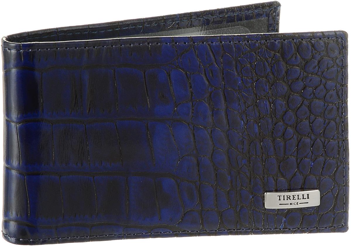 Футляр для карточек Tirelli Кроко, цвет: синий. 15-325-1515-325-15Футляр для карточек Tirelli Кроко изготовлен из натуральной кожи синего цвета с декоративным теснением под рептилию. Футляр оформлен фирменным логотипом. Внутри имеется 12 кармашков из прозрачного пластика для хранения пластиковых карт, визиток, дисконтных карт и т. п. Такой футляр не только поможет сохранить внешний вид ваших документов и защитит их от повреждений, но и станет ярким аксессуаром, который подчеркнет ваш образ. Изделие упаковано в подарочную коробку синего цвета с логотипом фирмы Tirelli. Характеристики: Материал: натуральная кожа, текстиль, пластик. Цвет: синий. Размер футляра (в сложенном виде): 11 см х 6,5 см.