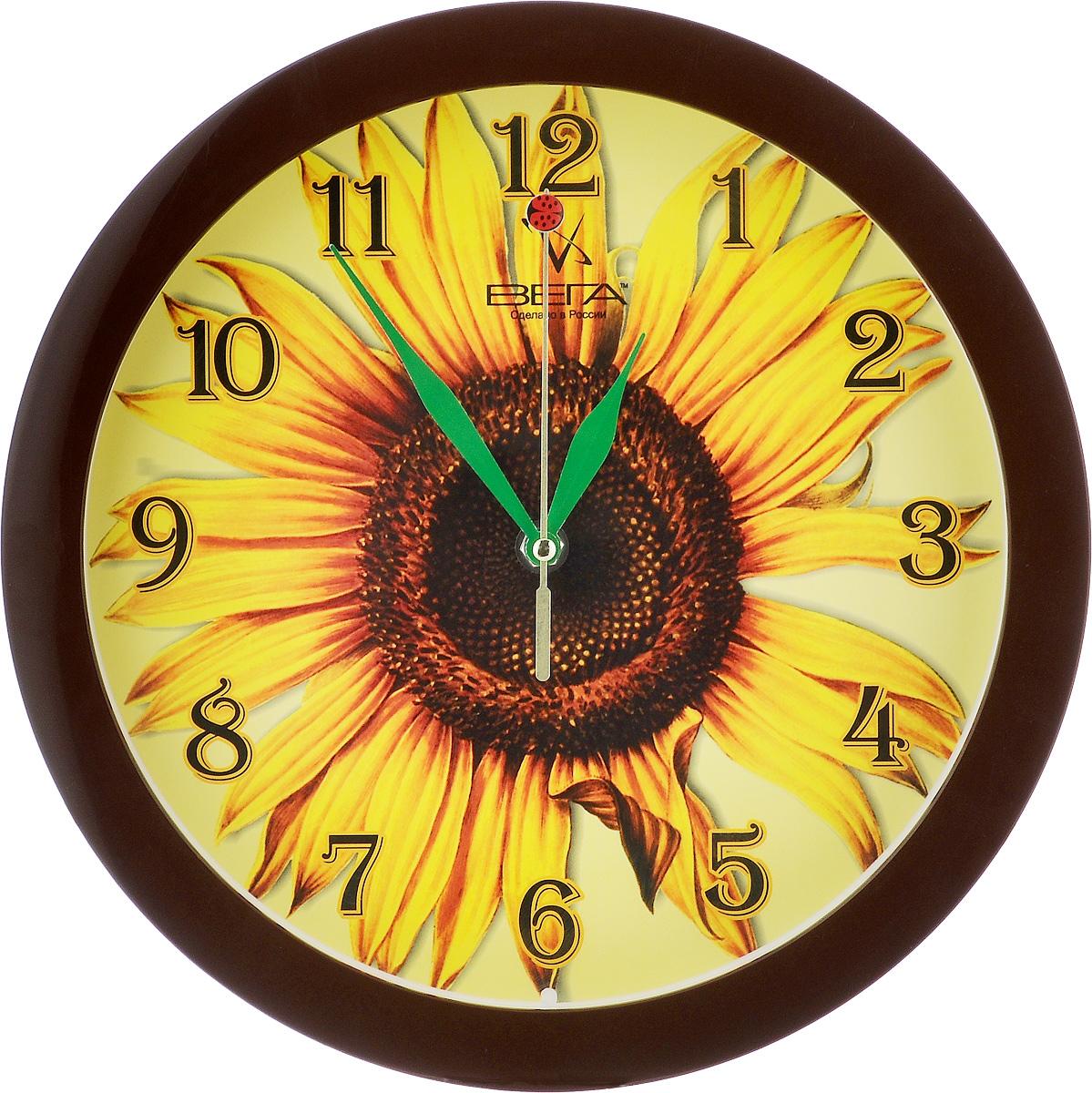 Часы настенные Вега Подсолнух, диаметр 28,5 смП1-9/7-15Настенные кварцевые часы Вега Подсолнух, изготовленные из пластика, прекрасно впишутся в интерьер вашего дома. Круглые часы имеют три стрелки: часовую, минутную и секундную, циферблат защищен прозрачным стеклом. Часы работают от 1 батарейки типа АА напряжением 1,5 В (не входит в комплект). Диаметр часов: 28,5 см.