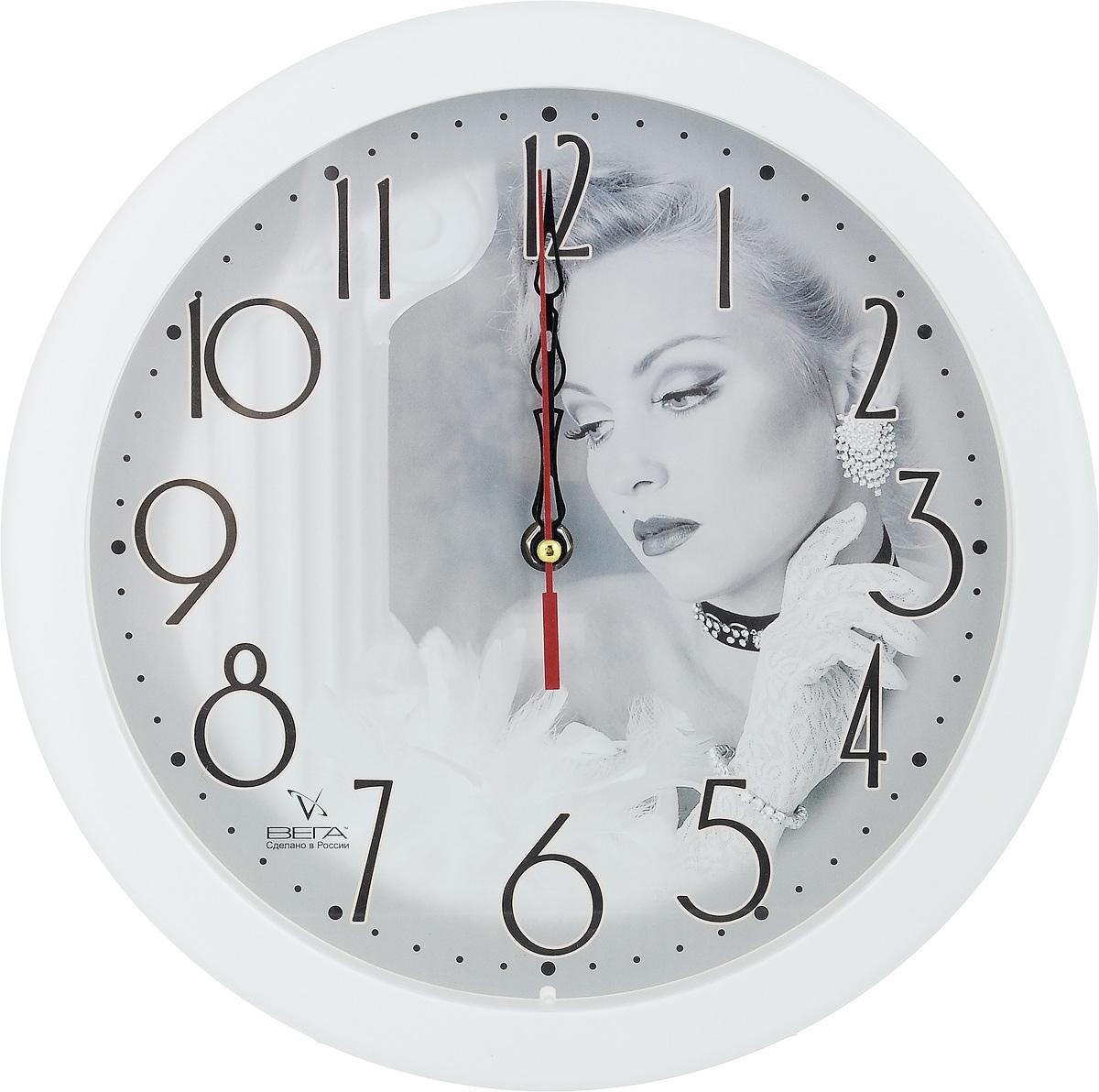 Часы настенные Вега Актриса, диаметр 28,5 смП1-7/7-24Настенные кварцевые часы Вега Актриса, изготовленные из пластика, прекрасно впишутся в интерьер вашего дома. Круглые часы имеют три стрелки: часовую, минутную и секундную, циферблат защищен прозрачным стеклом. Часы работают от 1 батарейки типа АА напряжением 1,5 В (не входит в комплект). Диаметр часов: 28,5 см.