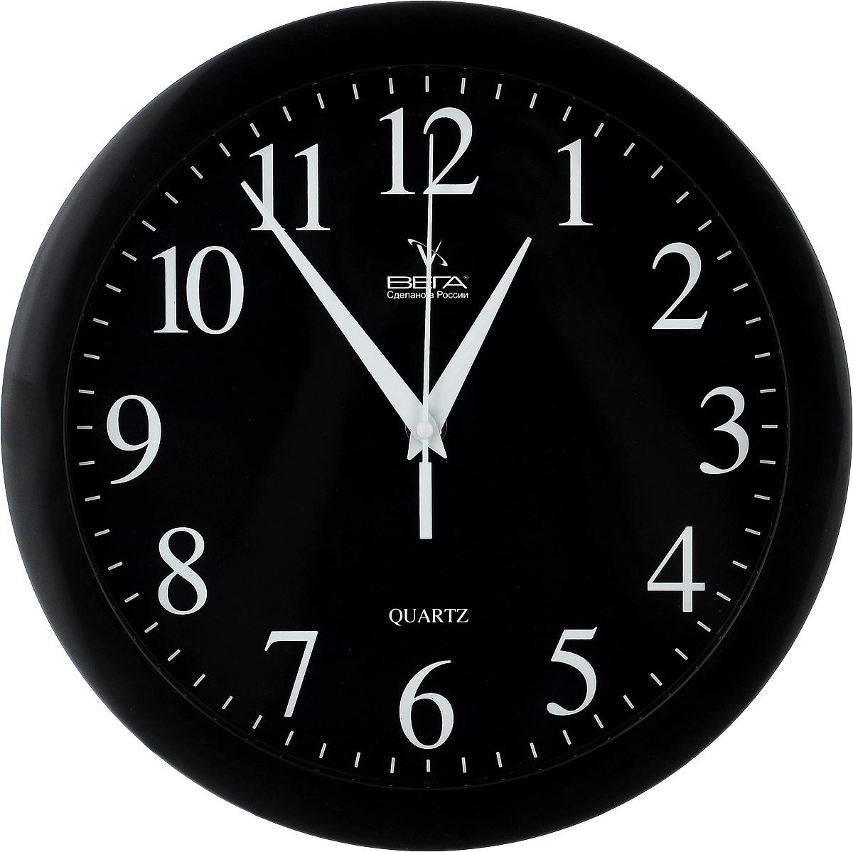 Часы настенные Вега Классика, цвет: черный, диаметр 28,5 см. П1-6П1-6/6-6Настенные кварцевые часы Вега Классика, изготовленные из пластика, прекрасно впишутся в интерьер вашего дома. Круглые часы имеют три стрелки: часовую, минутную и секундную, циферблат защищен прозрачным стеклом. Часы работают от 1 батарейки типа АА напряжением 1,5 В (не входит в комплект). Диаметр часов: 28,5 см.