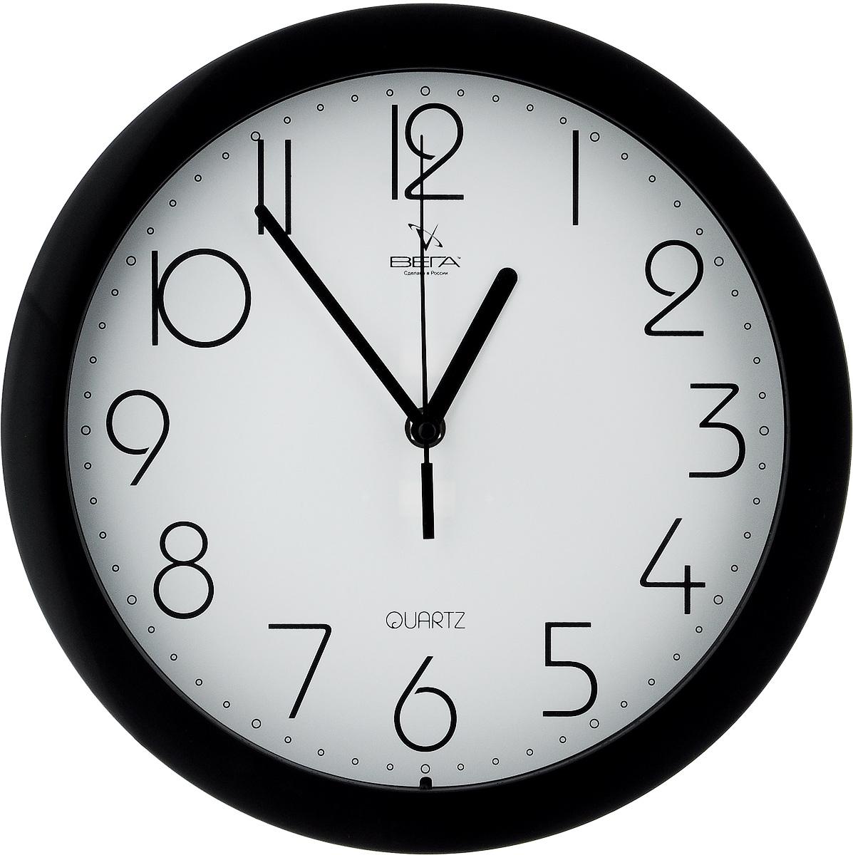 Часы настенные Вега Классика, цвет: черный, белый, диаметр 28,5 см. П1-6/6П1-6/6-4Настенные кварцевые часы Вега Классика, изготовленные из пластика, прекрасно впишутся в интерьер вашего дома. Круглые часы имеют три стрелки: часовую, минутную и секундную, циферблат защищен прозрачным стеклом. Часы работают от 1 батарейки типа АА напряжением 1,5 В (не входит в комплект). Диаметр часов: 28,5 см.