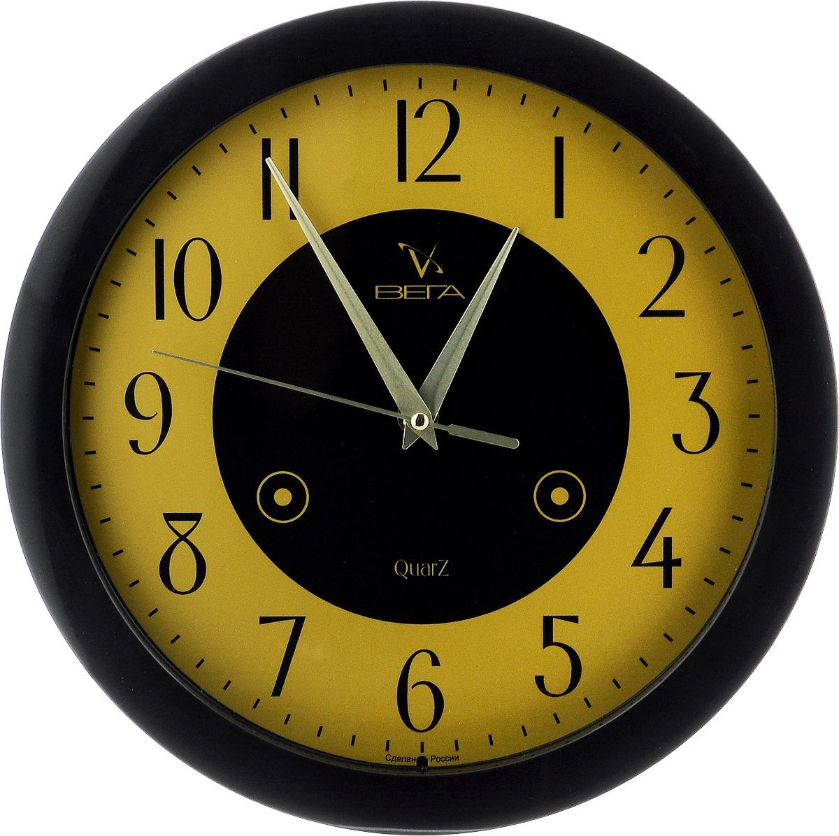 Часы настенные Вега Классика, цвет: черный, желтый, диаметр 28,5 см. П1-6/6П1-6/6-16Настенные кварцевые часы Вега Классика, изготовленные из пластика, прекрасно впишутся в интерьер вашего дома. Круглые часы имеют три стрелки: часовую, минутную и секундную, циферблат защищен прозрачным стеклом. Часы работают от 1 батарейки типа АА напряжением 1,5 В (не входит в комплект). Диаметр часов: 28,5 см.