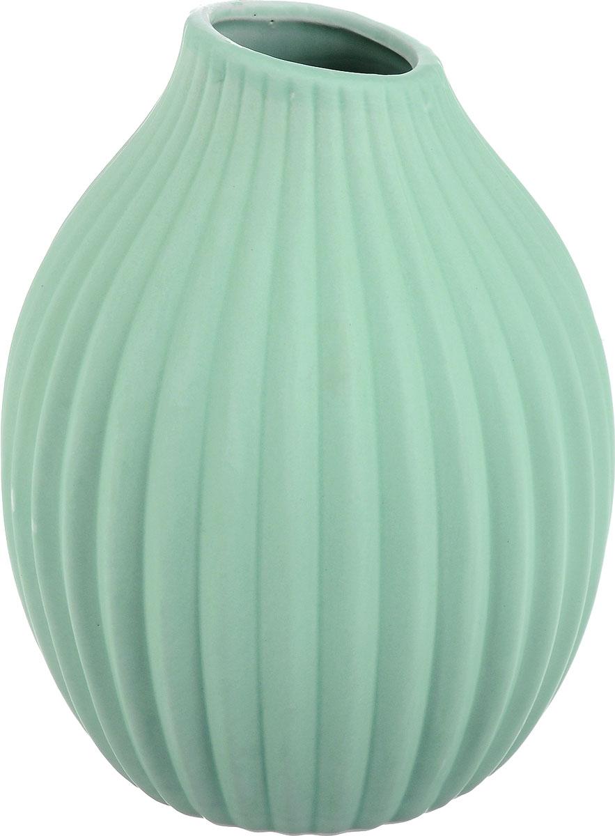 Ваза декоративная Феникс-Презент, цвет: светло-зеленый, высота 20 см43820Оригинальная ваза Феникс-Презент изготовлена из фаянса. Рельефная волнообразная поверхностью вазы делает ее изящным украшением интерьера. При желании изделие можно оформить по собственному вкусу, например, раскрасив его красками. Ваза Феникс-Презент дополнит интерьер офиса или дома и станет желанным и стильным подарком. Диаметр вазы: 15,5 см. Высота вазы: 20 см.