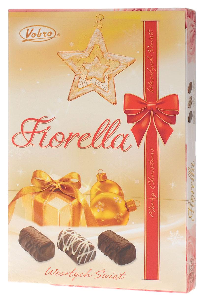 Vobro Fiorella Фиорелла набор шоколадных конфет, 140 г9352Fiorella - это 3 дополнительных вкуса, создающих набор, который не надоест. Под деликатным шоколадом скрыт вкус кокоса, ореха и капучино. Такой набор, несомненно, порадует каждую женщину. Уважаемые клиенты! Обращаем ваше внимание, что полный перечень состава продукта представлен на дополнительном изображении.