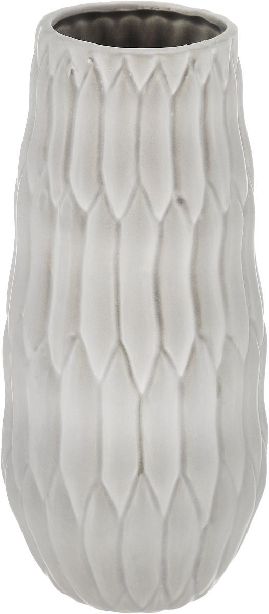Ваза декоративная Феникс-Презент, высота 22,3 см43827Оригинальная ваза Феникс-Презент изготовлена из фаянса. Рельефная поверхностью вазы делает ее изящным украшением интерьера. При желании изделие можно оформить по собственному вкусу, например раскрасив его красками. Ваза Феникс-Презент дополнит интерьер офиса или дома и станет желанным и стильным подарком. Диаметр вазы по верхнему краю: 7 см. Диаметр дна: 6 см. Высота вазы: 22,3 см.