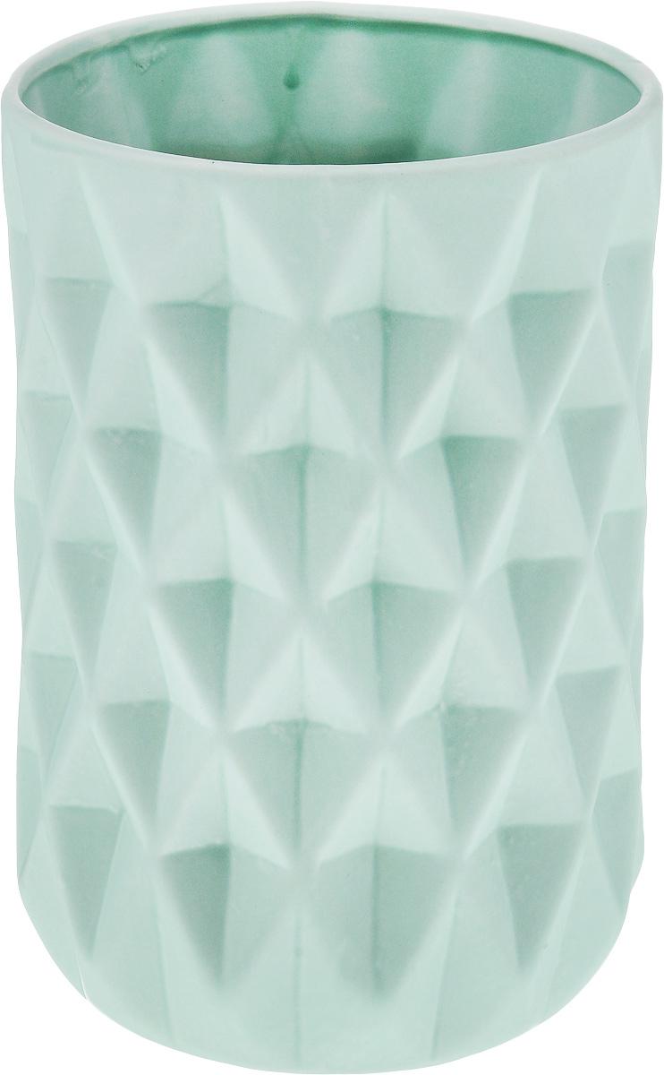 Ваза декоративная Феникс-Презент, высота 23 см. 4382643826Оригинальная ваза Феникс-Презент изготовлена из фаянса. Рельефная поверхностью вазы делает ее изящным украшением интерьера. При желании изделие можно оформить по собственному вкусу, например раскрасив его красками. Ваза Феникс-Презент дополнит интерьер офиса или дома и станет желанным и стильным подарком. Диаметр вазы по верхнему краю: 14 см. Диаметр дна: 12 см. Высота вазы: 23 см.