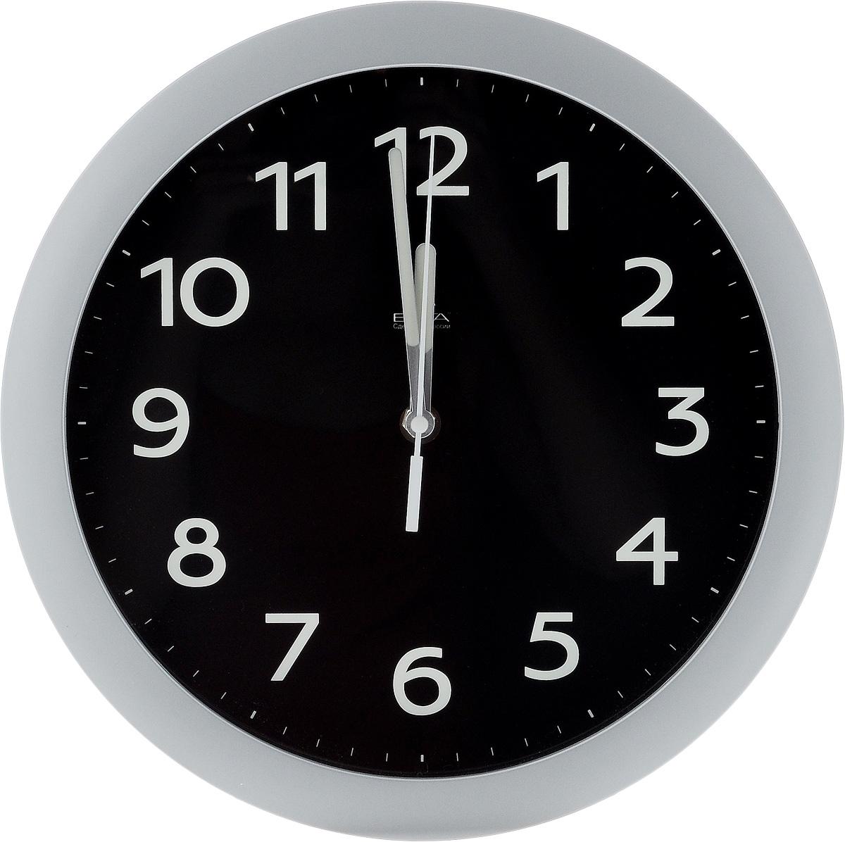 Часы настенные Вега Фосфор, диаметр 28,5 смП1-серебро/6-212Настенные кварцевые часы Вега Фосфор, изготовленные из пластика, прекрасно впишутся в интерьер вашего дома. Круглые часы имеют три стрелки: часовую, минутную и секундную, циферблат защищен прозрачным стеклом. Часы работают от 1 батарейки типа АА напряжением 1,5 В (не входит в комплект). Диаметр часов: 28,5 см.