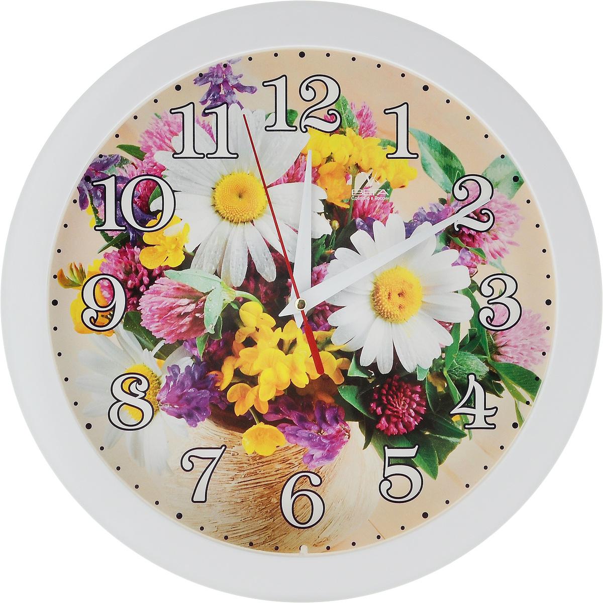 Часы настенные Вега Маринина радость, диаметр 28,5 смП1-7/7-219Настенные кварцевые часы Вега Маринина радость, изготовленные из пластика, прекрасно впишутся в интерьер вашего дома. Часы имеют три стрелки: часовую, минутную и секундную, циферблат защищен прозрачным стеклом. Часы работают от 1 батарейки типа АА напряжением 1,5 В (не входит в комплект). Диаметр часов: 28,5 см.