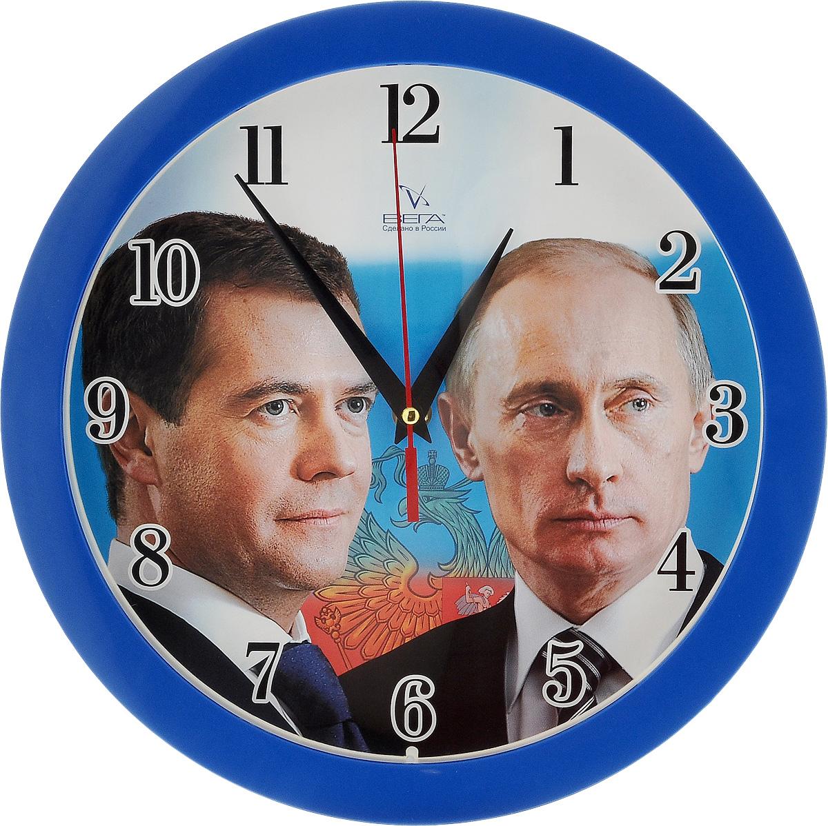 Часы настенные Вега Первые лица, диаметр 28,5 смП1-10/7-40Настенные кварцевые часы Вега Первые лица, изготовленные из пластика, прекрасно впишутся в интерьер вашего дома. Круглые часы имеют три стрелки: часовую, минутную и секундную, циферблат защищен прозрачным стеклом. Часы работают от 1 батарейки типа АА напряжением 1,5 В (не входит в комплект). Диаметр часов: 28,5 см.