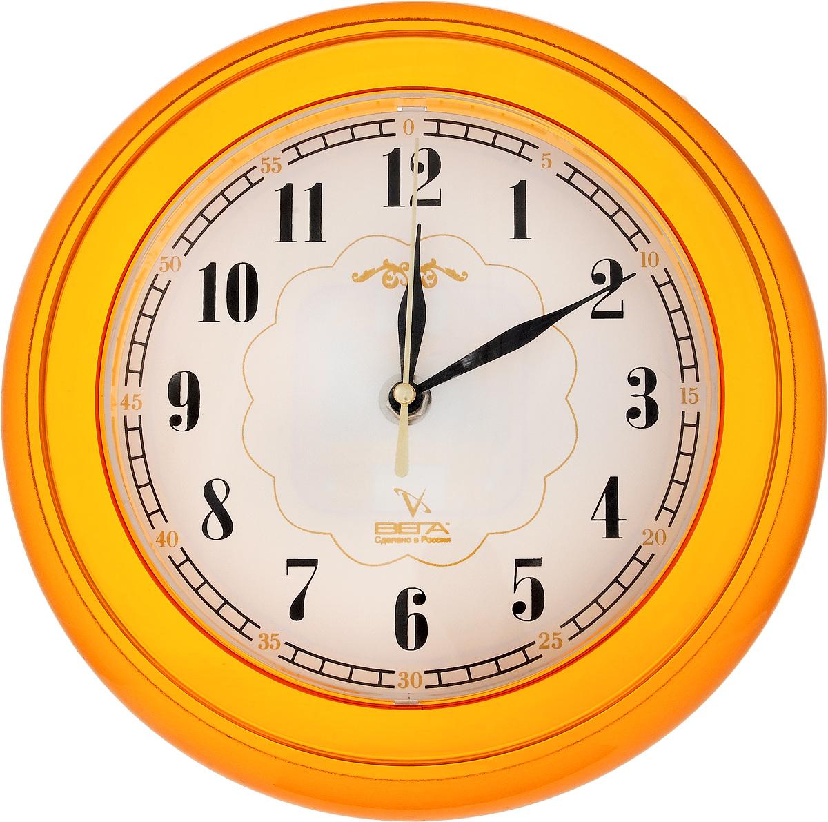 Часы настенные Вега Классика, цвет: оранжевый, диаметр 22 смП6-17-20Настенные кварцевые часы Вега Классика, изготовленные из пластика, прекрасно впишутся в интерьер вашего дома. Круглые часы имеют три стрелки: часовую, минутную и секундную, циферблат защищен прозрачным стеклом. Часы работают от 1 батарейки типа АА напряжением 1,5 В (не входит в комплект). Диаметр часов: 22 см.