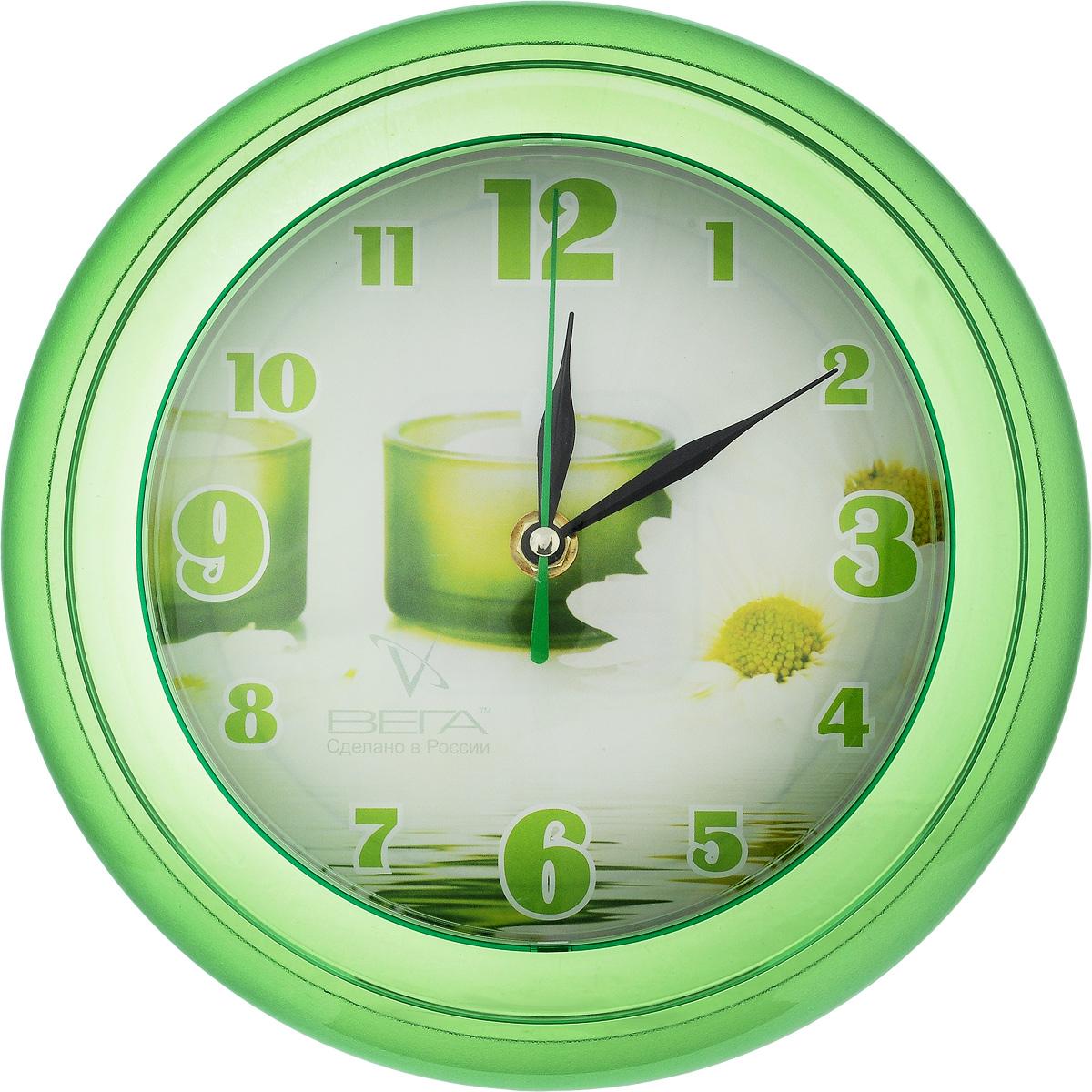 Часы настенные Вега Свеча зеленая, диаметр 22 смП6-3-10Настенные кварцевые часы Вега Свеча зеленая, изготовленные из пластика, прекрасно впишутся в интерьер вашего дома. Круглые часы имеют три стрелки: часовую, минутную и секундную, циферблат защищен прозрачным стеклом. Часы работают от 1 батарейки типа АА напряжением 1,5 В (не входит в комплект). Диаметр часов: 22 см.