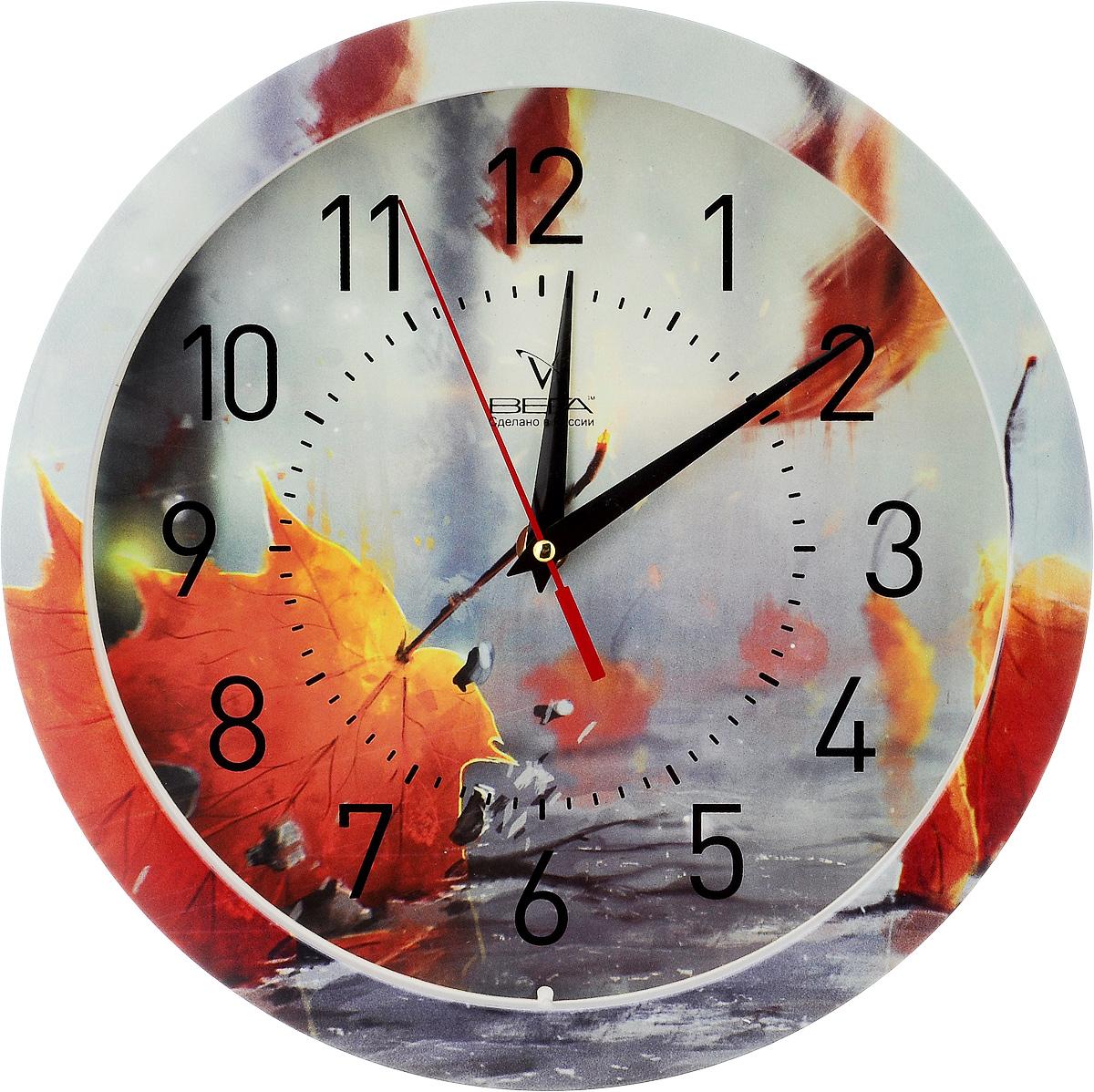 Часы настенные Вега Осень, диаметр 28,5 смП1-240/7-240Настенные кварцевые часы Вега Осень, изготовленные из пластика, прекрасно впишутся в интерьер вашего дома. Часы имеют три стрелки: часовую, минутную и секундную, циферблат защищен прозрачным стеклом. Часы работают от 1 батарейки типа АА напряжением 1,5 В (не входит в комплект). Диаметр часов: 28,5 см.