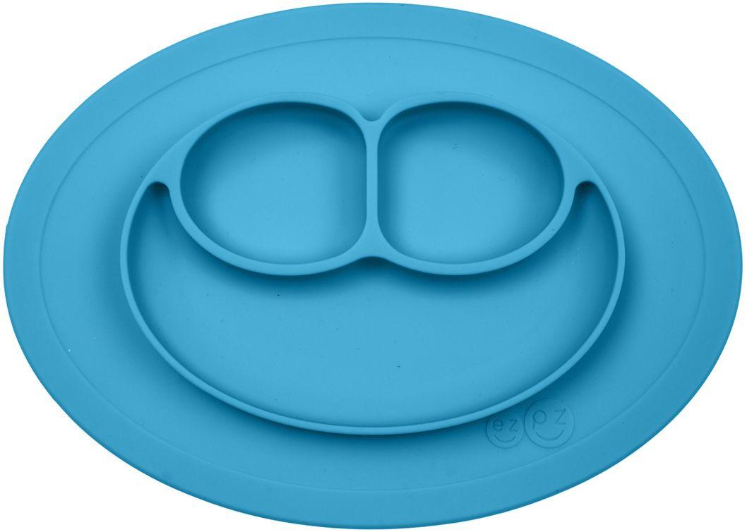 Ezpz Тарелка детская Mini Mat цвет голубойPCMMB003Ezpz Mini Mat - уменьшенная версия тарелочки-плейсмата Happy Mat. Предназначена для столиков для кормления и использования в поездках. Рекомендована для малышей от 4 месяцев. Тарелка тоньше, легче и компактнее, чем Happy Mat, но обладает теми же отличительными чертами: присасывается к столу, чтобы ребенок не смог ее перевернуть; подходит для микроволновки и посудомоечной машины; улыбается и вызывает у детей улыбку. Вмещает 240 мл. У тарелочки также есть удобный чехольчик с ручками, который легко можно взять с собой. Тарелка разработана и запатентована в США. Идея создания удобной безопасной посуды для детей принадлежит многодетной маме, которая как никто другой знает, как сложно уследить за детками во время еды и сохранить при этом чистоту и порядок. Благодаря такой тарелочке прием пищи становится веселым и безопасным, а кухня остается чистой и опрятной.