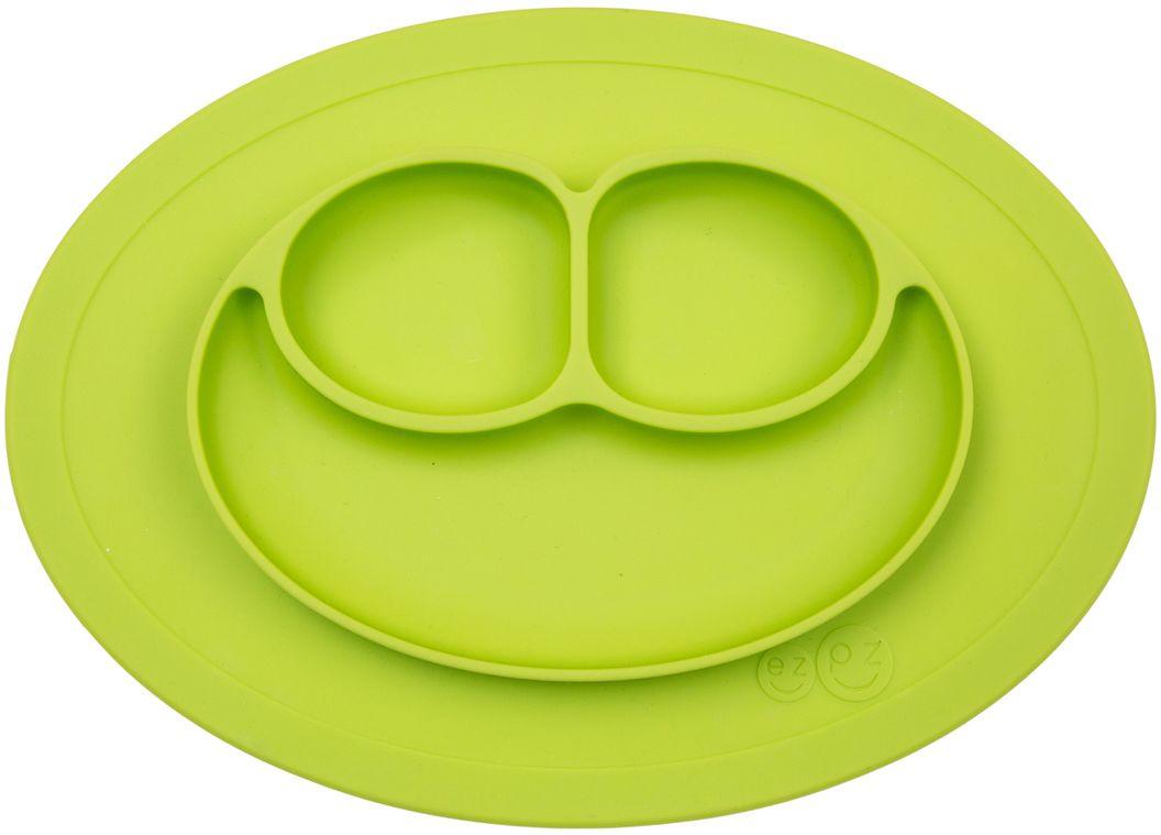 Ezpz Тарелка детская Mini Mat цвет зеленыйPCMMG001Ezpz Mini Mat - уменьшенная версия тарелочки-плейсмата Happy Mat. Предназначена для столиков для кормления и использования в поездках. Рекомендована для малышей от 4 месяцев. Тарелка тоньше, легче и компактнее, чем Happy Mat, но обладает теми же отличительными чертами: присасывается к столу, чтобы ребенок не смог ее перевернуть; подходит для микроволновки и посудомоечной машины; улыбается и вызывает у детей улыбку. Вмещает 240 мл. У тарелочки также есть удобный чехольчик с ручками, который легко можно взять с собой. Тарелка разработана и запатентована в США. Идея создания удобной безопасной посуды для детей принадлежит многодетной маме, которая как никто другой знает, как сложно уследить за детками во время еды и сохранить при этом чистоту и порядок. Благодаря такой тарелочке прием пищи становится веселым и безопасным, а кухня остается чистой и опрятной.