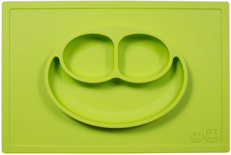 Ezpz Тарелка детская Happy Mat цвет зеленыйPKHMG001Ezpz Happy Mat - необычная силиконовая тарелка-плейсмат, которая не имеет аналогов. Ее главная особенность заключается в том, что тарелку невозможно перевернуть или опрокинуть. С ней ребенок не сможет испачкать стол или, что гораздо важнее, обжечься горячей пищей. Изготовлена из силикона высочайшего качества и абсолютно безопасна. Не имеет липучек или присосок - фиксация происходит на любой ровной горизонтальной поверхности за счет плоской, гладкой поверхности тарелочки - мата. Подходит для использования в микроволновке и посудомоечной машине. Выглядит как улыбающаяся рожица, что очень нравится детям и их мамам. Тарелка разработана и запатентована в США. Идея создания удобной, безопасной посуды для детей, принадлежит многодетной маме, которая как никто другой знает, как сложно уследить за детками во время еды и сохранить при этом чистоту и порядок. Благодаря такой тарелочке прием пищи становится веселым и безопасным, а кухня остается чистой и опрятной. Объем 540 мл.