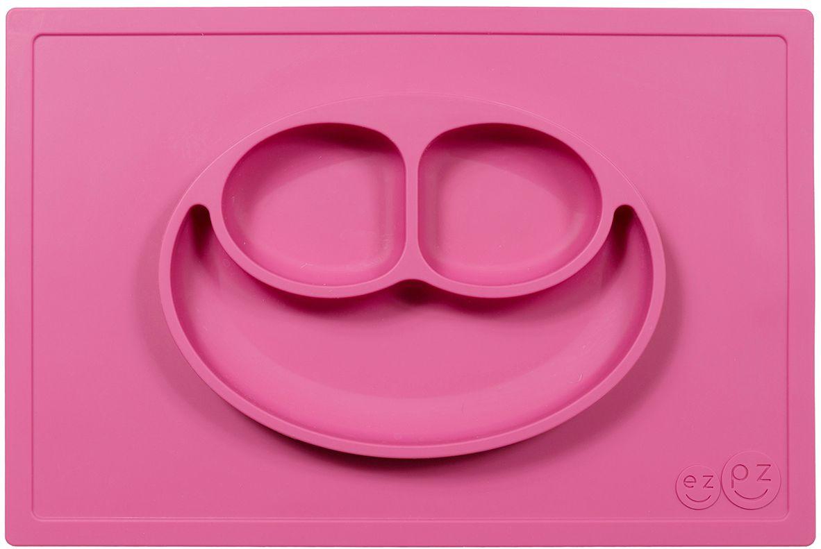 Ezpz Тарелка детская Happy Mat цвет розовыйPKHMP002Ezpz Happy Mat - необычная силиконовая тарелка-плейсмат, которая не имеет аналогов. Ее главная особенность заключается в том, что тарелку невозможно перевернуть или опрокинуть. С ней ребенок не сможет испачкать стол или, что гораздо важнее, обжечься горячей пищей. Изготовлена из силикона высочайшего качества и абсолютно безопасна. Не имеет липучек или присосок - фиксация происходит на любой ровной горизонтальной поверхности за счет плоской, гладкой поверхности тарелочки - мата. Подходит для использования в микроволновке и посудомоечной машине. Выглядит как улыбающаяся рожица, что очень нравится детям и их мамам. Тарелка разработана и запатентована в США. Идея создания удобной, безопасной посуды для детей, принадлежит многодетной маме, которая как никто другой знает, как сложно уследить за детками во время еды и сохранить при этом чистоту и порядок. Благодаря такой тарелочке прием пищи становится веселым и безопасным, а кухня остается...
