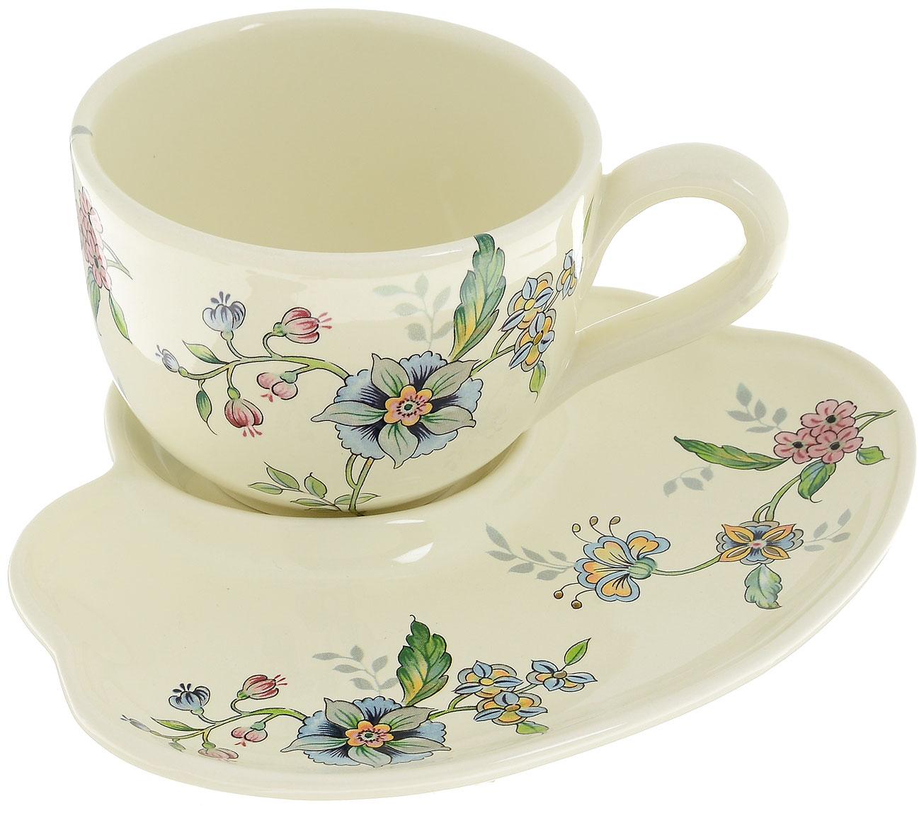 Набор для завтрака Nuova Cer Прованс, 2 предметаPRV-7960Набор для завтрака Nuova Cer Прованс состоит из чашки и тарелки, изготовленных из высококачественной керамики. Изделия оформлены цветочным узором. Красочность оформления придется по вкусу и ценителям классики, и тем, кто предпочитает утонченность и изысканность. Такой набор прекрасно дополнит сервировку стола к завтраку и подчеркнет ваш безупречный вкус. Набор для завтрака Nuova Cer Прованс - это прекрасный подарок к любому случаю. Изделия нельзя мыть в посудомоечной машине. Объем чашки: 600 мл. Диаметр чашки (по верхнему краю): 12 см. Высота чашки: 9 см. Размер тарелки: 20 х 23 см.