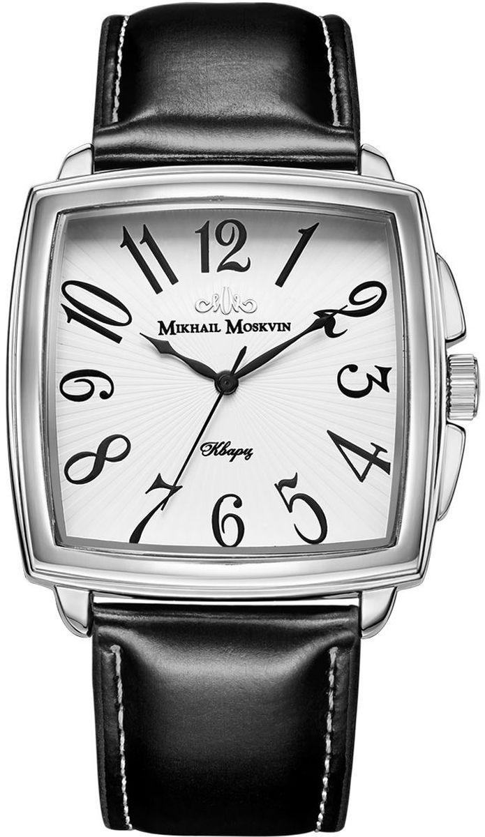 Часы наручные мужские Mikhail Moskvin, цвет: серебристый. 1039A1L61039A1L6Модель является достойным продолжателем элегантного стиля коллекции CLASSIC, выпущенной Угличским часовым заводом. В ней проявилась безграничность форм неповторимой часовой классики. Квадратный двухуровневый корпус шириной 43 мм со слегка выпуклыми боками дополнен небольшими ушками и скругленными предохранителями вокруг переводной головки и покрыт по современной технологии – ионным напылением стали. Развернутые черные арабские цифры на белом поле циферблата являются эталоном эстетики и хорошего вкуса. Изящества часам добавляют черные стрелки необычной формы. Высокоточный японский кварцевый механизм, производства фирмы Seiko Epson, оснащен часовой, минутной и секундной стрелками. Срок службы элемента питания 2 года. Гладкий черный ремень со стальной застежкой - гарантируют комфорт и надежность.