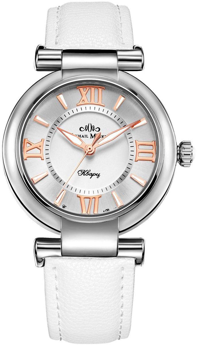 Часы наручные женские Mikhail Moskvin Каприз, цвет: белый. 1148A1L1/21148A1L1/2Эти часы вызывают неизменное восхищение классической красотой дизайна и уникальной философией, суть которой заключается в желании сохранить ценности, проверенные временем. Круглый серебристый корпус диаметром 36 мм и белый ремень изготовлены из материалов высокого качества. Элегантность корпуса дополняется стильным серебристым циферблатом с золотистой римской оцифровкой и широкими стрелками с белым заполнением. Часы оснащены японским кварцевым механизмом. Срок службы элемента питания 2 года. Задняя крышка изготовлена из высокотехнологичной нержавеющей стали. Минеральное стекло обеспечивает устойчивость к царапинам. Ремень фиксирует на запястье элегантная застежка - признак комфорта и надежности. В результате получилась модель, сочетающая повседневное удобство и вневременную элегантность.