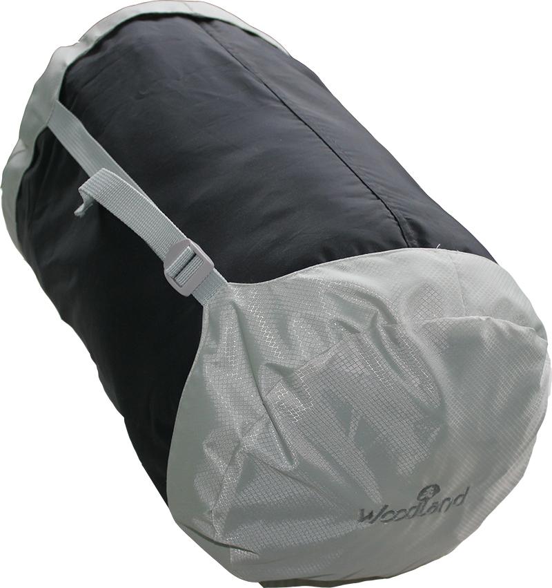 Компрессионный мешок Woodland Compression Bag, 45 x 25 см, цвет: черный, серый43798Модель: Compression Bag Цвет: черный, серый Размер: 45 x 25 см. Материал: Polyester 210D Полезный аксессуар для эффективной упаковки и транспортировки спального мешка или другой необходимой экипировки. Позволяет уменьшить полезный объем вещей до 50%. Четырехсторонняя система строп и качественная фурнитура позволяет надежно зафиксировать необходимый уровень компрессии.