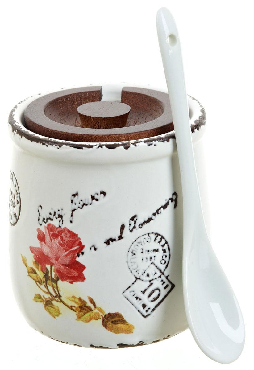Банка для сыпучих продуктов ENS Group Чайная роза, с ложой, 250 мл1750041Банка для сыпучих продуктов изготовлена из высококачественной керамики, в комплект входит ложка. Изделие оформлено красочным изображением. Банка прекрасно подойдет для хранения различных сыпучих продуктов: чая, кофе, сахара, соли. Изящная емкость не только поможет хранить разнообразные сыпучие продукты, но и стильно дополнит интерьер кухни.
