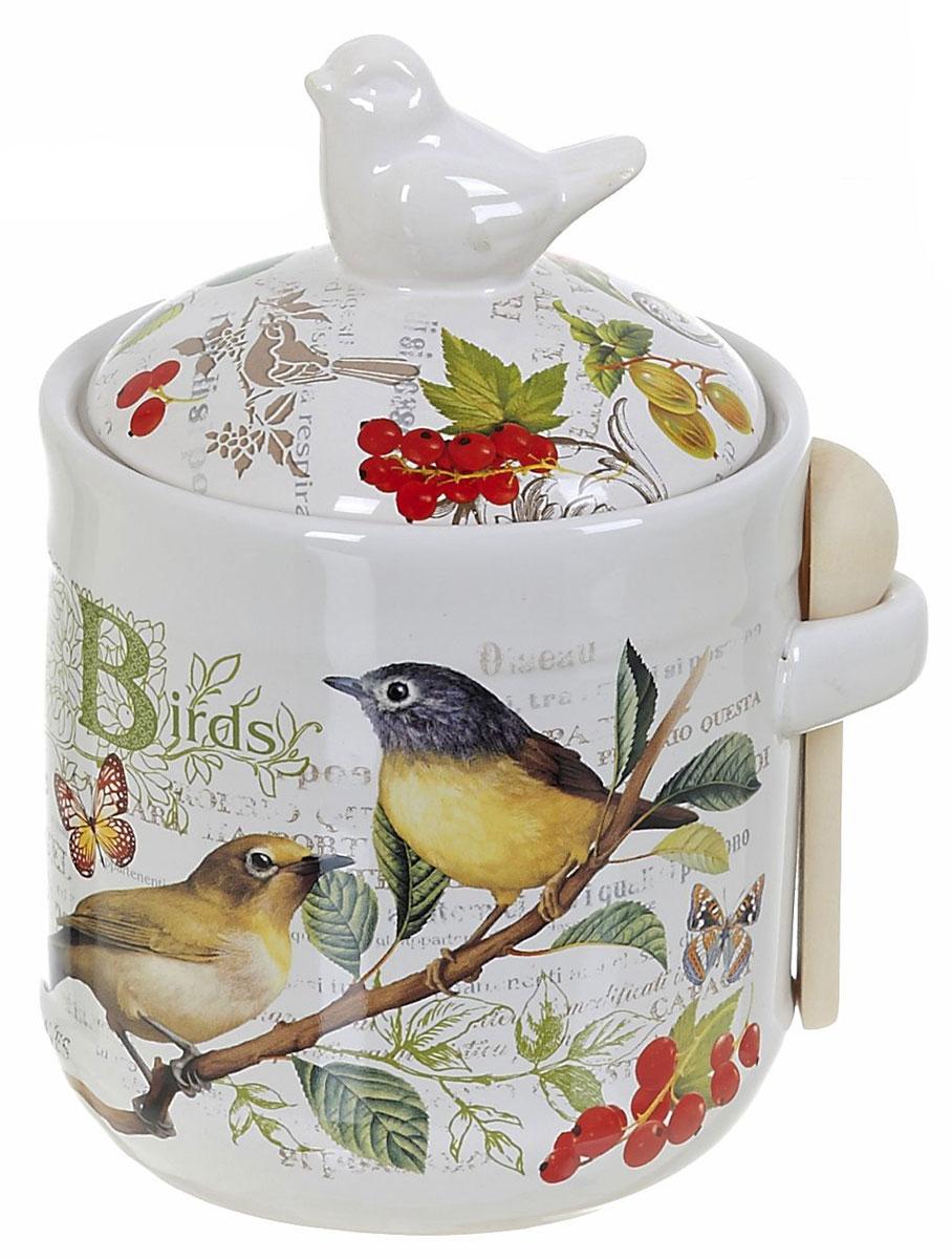 Банка для сыпучих продуктов Polystar Birds, с ложкой, 800 млL2430762Банка для сыпучих продуктов изготовлена из прочной доломитовой керамики, покрытой слоем сверкающей гладкой глазури. Изделие оформлено красочным изображением. В комплект входит деревянная ложечка. Банка прекрасно подойдет для хранения различных сыпучих продуктов: чая, кофе, сахара, круп и многого другого. Изящная емкость не только поможет хранить разнообразные сыпучие продукты, но и стильно дополнит интерьер кухни.
