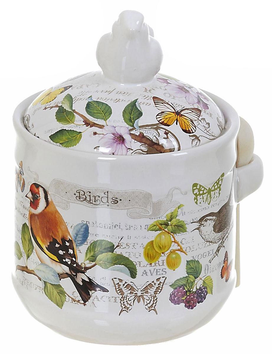 Банка для сыпучих продуктов Polystar Birds, с ложкой, 750 млL2430763Банка для сыпучих продуктов Birds. Изделие выполнено из прочной доломитовой керамики высокого качества. Гладкая и ровная глазурованная поверхность обеспечивает легкую очистку. Изделия декорированы красочным рисунком. Банка прекрасно подойдет для хранения различных сыпучих продуктов: специй, чая, кофе, сахара, круп и многого другого. Крышка плотно прилегает к стенкам емкости. Можно использовать в микроволновой печи, в холодильнике и посудомоечной машине.