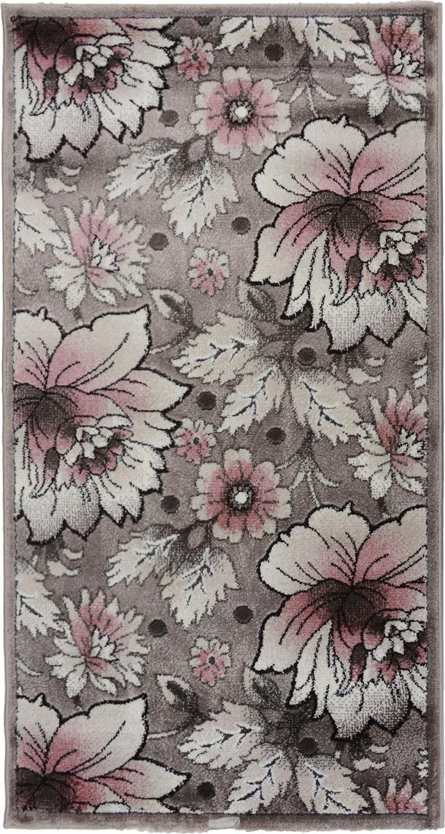 Ковер Mutas Carpet Symphony Carved, прямоугольный, цвет: розовый, серый, 80 х 150 см203420130212181093Ковер Mutas Carpet Symphony Carved изготовлен из прочного синтетического материала heat-set, улучшенного варианта полипропилена (эта нить получается в результате его дополнительной обработки). Полипропилен износостоек, нетоксичен, не впитывает влагу, не провоцирует аллергию. Структура волокна в полипропиленовых коврах гладкая, поэтому грязь не будет въедаться и скапливаться на ворсе. Практичный и износоустойчивый ворс не истирается и не накапливает статическое электричество. Ковер обладает хорошими показателями теплостойкости и шумоизоляции. Оригинальный рисунок позволит гармонично оформить интерьер комнаты, гостиной или прихожей. За счет невысокого ворса ковер легко чистить. При надлежащем уходе синтетический ковер прослужит долго, не утратив ни яркости узора, ни блеска ворса, ни упругости. Самый простой способ избавить изделие от грязи - пропылесосить его с обеих сторон (лицевой и изнаночной). Влажная уборка с применением ...