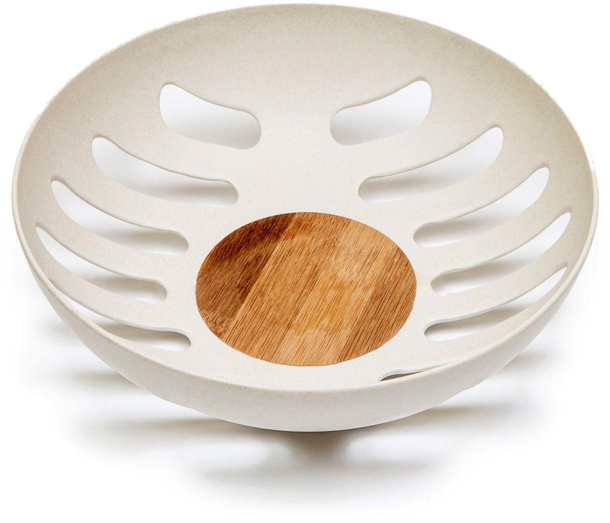 Фруктовница MOULINvilla, цвет: белый, 21,8 х 21,8 х 6,3 смTSF-24-WФруктовница MOULINvilla, изготовленная из природного бамбука, очищенного от вредных примесей идеально подходит для хранения и красивой сервировки любых фруктов. Для окраски используются натуральные пищевые красители. Бамбук, сам по себе, является природным антисептиком. Эта уникальная особенность посуды гарантирует безопасность при эксплуатации и хранении различных видов пищевой продукции. Можно мыть в посудомоечной машине.
