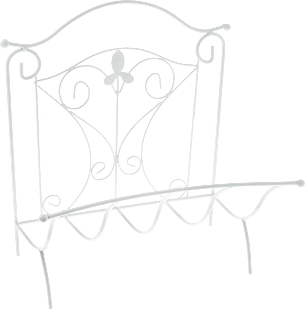 Подставка для газет Magic Home Французская лилия, 39 х 31 х 39 см44165Удобная подставка Magic Home Французская лилия предназначена для хранения газет и журналов. Изделие выполнено из кованого металла в классическом стиле. Изделие украшено изящными завитками и цветком из металла. Подставка располагается на удобных металлических ножках. Такая подставка поможет не только хранить газеты и журналы в одном месте, но и станет предметом декора. Размер подставки: 39 х 31 х 39 см.