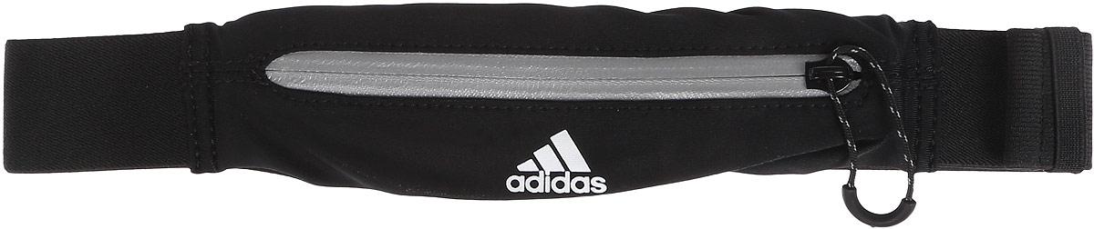 Сумка поясная для бега Adidas Run Belt, цвет: черный, белый, серыйS96357Сумка Adidas Run Belt выполнена из нейлона и эластана, оформлена символикой бренда. Сумка фиксируется на поясе с помощью застежки-фастекс. Сумка имеет удобный карман для мелочей на застежке- молнии, таких как ключи или деньги. Изделие оснащено светоотражающими деталями. Такая поясная сумка для бега станет настоящей находкой как для любителей, так и для профессиональных спортсменов, которые действительно серьезно подходят к экипировке. Длина пояса (с учетом сумки): 45-82 см.