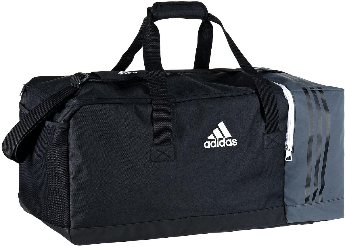Сумка спортивная Adidas Tiro TB, цвет: черный, темно-серый, 70 х 32 х 31 смB46126Стильная спортивная сумка Adidas Tiro TB выполнена из полиэстера и полиэфира. Изделие имеет одно отделение, закрывающееся на застежку-молнию. Внутри расположены два накладных открытых кармана и нашивной карман на застежке- молнии. Снаружи, с одной из боковых сторон находится вентилируемый карман для обуви на застежке-молнии, с другой стороны - сетчатый карман. Основание изделия выполнено из более плотного материала с полиуретановым покрытием, что обеспечивает защиту от влаги и дополнено пластиковыми ножками. Сумка оснащена двумя удобными ручками для переноски в руках и регулируемым наплечным ремнем.