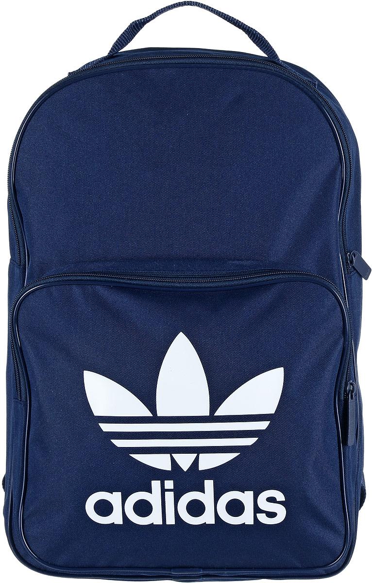 Рюкзак спортивный Adidas Trefoil, цвет: синий, 23 лBK6724Спортивный рюкзак Adidas Trefoil выполнен из полиэстера. Изделие имеет одно отделение, которое застегивается на застежку-молнию. Внутри находится вместительный накладной карман для ноутбука. Снаружи, на передней стенке расположен накладной карман на застежке-молнии, оформленный фирменным логотипом и названием бренда. Рюкзак оснащен широкими регулируемыми лямками и ручкой для переноски в руке.