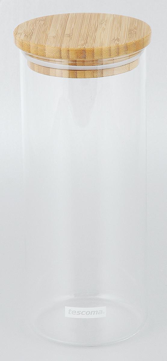 Банка для сыпучих продуктов Tescoma Fiesta, 1,4 л894624Банка Tescoma Fiesta изготовлена из высококачественного стекла. Емкость подходит для хранения сыпучих продуктов: круп, специй, сахара, соли. Она снабжена деревянной крышкой, которая плотно и герметично закрывается, дольше сохраняя аромат и свежесть содержимого. Банка Tescoma Fiesta станет полезным приобретением и пригодится на любой кухне. Высота банки (без учета крышки): 23 см. Высота банки (с учетом крышки): 24 см. Диаметр банки (по верхнему краю): 9,5 см. Объем банки: 1,4 л.