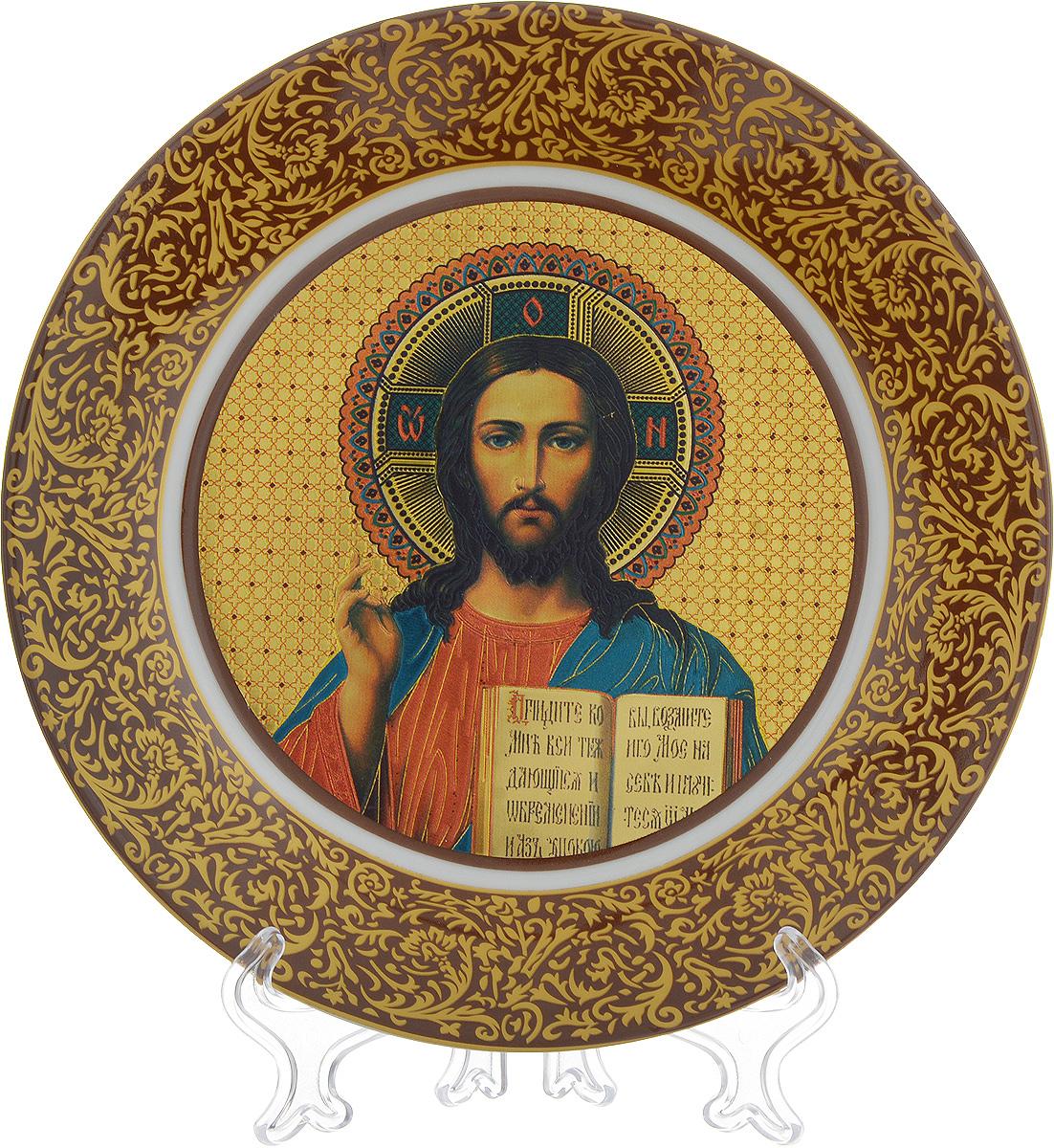 Тарелка декоративная Elan Gallery Иисус Христос, диаметр 20 см340026Декоративная тарелка Elan Gallery Иисус Христос, изготовленная из керамики, станет необыкновенным подарком для верующих людей и оригинальным украшением на Пасху. Тарелка оснащена петелькой для подвешивания, а также ее можно разместить на пластиковой подставке, которая входит в комплект. Диаметр тарелки: 20 см. Высота: 2 см.